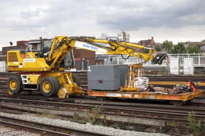 Balfour Beatty XEC2411 (99709 940431 8) and trailer 010311 at Clapham Junction  by ontrackplant.com