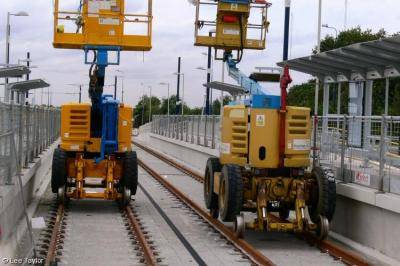 Pod-Trak Genies Z-45/22 PTL125 & PTL129 at Ashton West Metrolink Station  by Lee Taylor